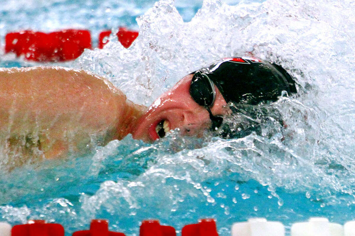 New Canaan's Jake Ritz competes in the 400 yard freestyle realy during swim action against Greenwich in Greenwich, Conn., on Friday Jan. 11, 2019. - Christian Abraham/Hearst Connecticut Media photo