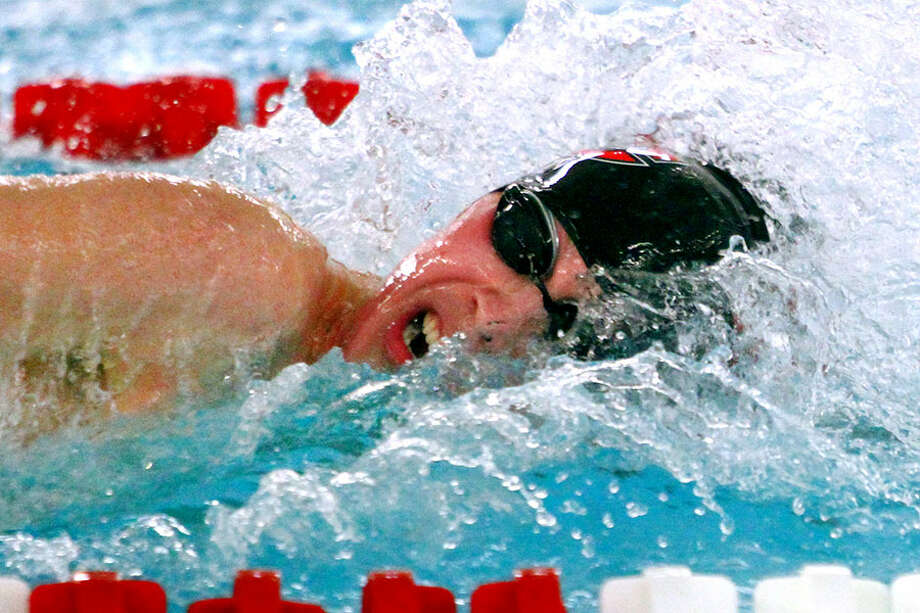 New Canaan's Jake Ritz competes in the 400 yard freestyle realy during swim action against Greenwich in Greenwich, Conn., on Friday Jan. 11, 2019. — Christian Abraham/Hearst Connecticut Media photo / Connecticut Post