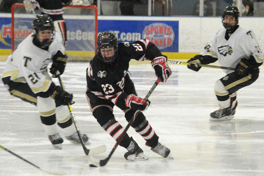 New Canaan's Boden Gammill skates up the ice during the Rams' 4-3 win over Trumbull at The Rinks at Shelton on Saturday, Jan. 12. — Andy Hutchison photo