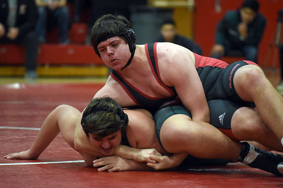 New Canaan sophomore Ben Clay wrestles with Norwalk freshman Tom Jakaj in the heavyweight bout during a wrestling match at New Canaan High School on Wednesday, Jan. 9. — Dave Stewart photo