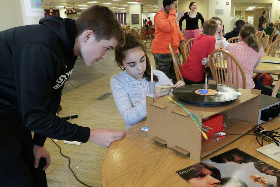 "New Canaan residents Will Thomas and Nicole Ayoub work on their innovations at St. Luke's 2018 Hackathon. This year's ""St. Luke's Hilltop Hackathon"" is held overnight on the school's campus Jan. 19-20. — Valerie Parker Photo"