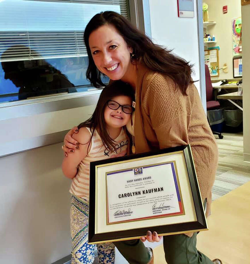 Carolynn Kaufman, New Canaan YMCA Director of Special Needs Programming, shown with Amber Lehrman at New Canaan YMCA on Dec. 8, received the Many Hands Award in the Constant Contributor category from the Down Syndrome Association of Connecticut.