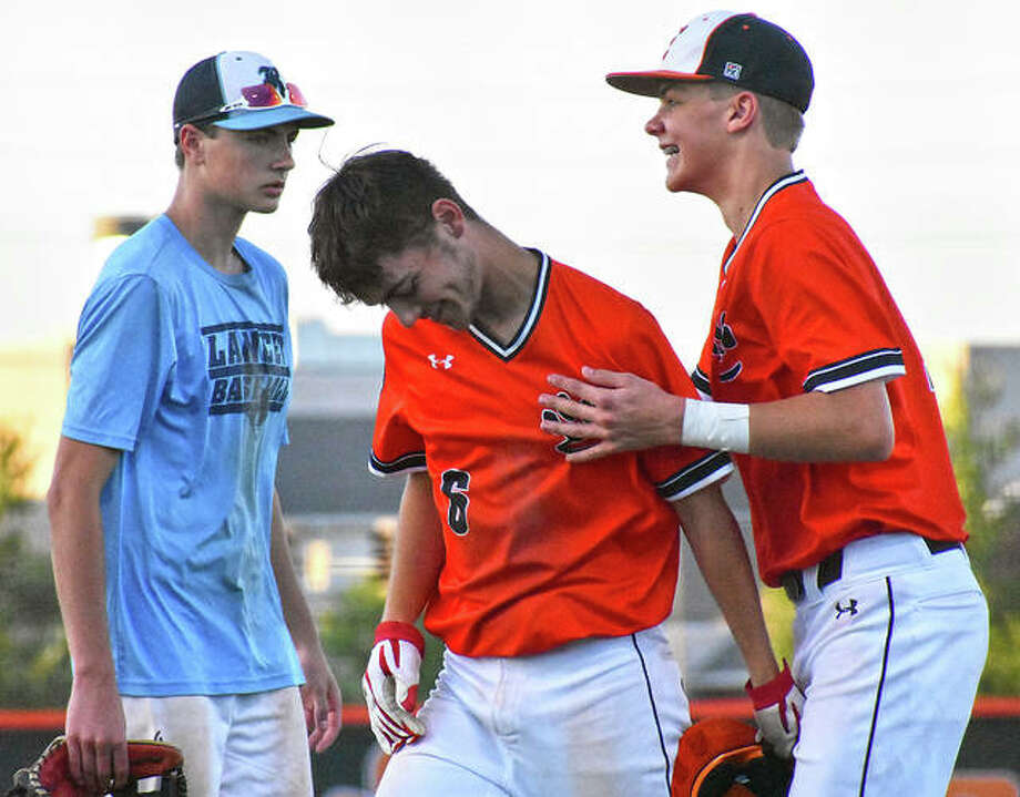 Austin Segrest, center, is congratulated after his walk-off base hit in the seventh inning against Belleville East. Photo: Matt Kamp/The Intelligencer