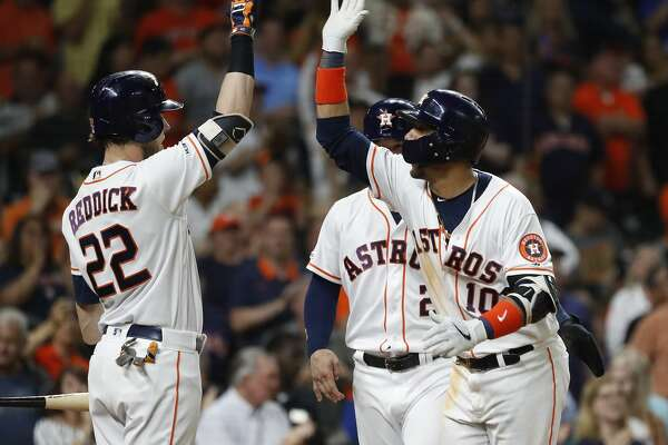 Houston Astros first baseman Yuli Gurriel (10) celebrates with Josh Reddick (22) after hitting a two-run home run off of Pittsburgh Pirates starting pitcher Trevor Williams during the fourth inning of an MLB baseball game at Minute Maid Park, Tuesday, June 25, 2019.