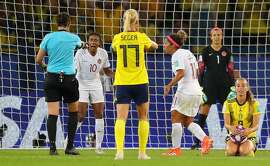 PARIS, FRANCE - JUNE 24: Referee Kate Jacewiz awards Swedena a penalty after Fridolina Rolfo of Sweden (not pictured) is fouled inside the penalty area by Ashley Lawrence of Canada but the decision is then rescinded following a VAR review during the 2019 FIFA Women's World Cup France Round Of 16 match between Sweden and Canada at Parc des Princes on June 24, 2019 in Paris, France. (Photo by Richard Heathcote/Getty Images)