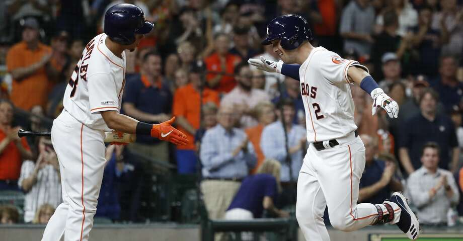 Houston Astros Alex Bregman (2) celebrates his home run with Michael Brantley (23) during the sixth inning of an MLB baseball game at Minute Maid Park, Tuesday, June 25, 2019. Photo: Karen Warren/Staff Photographer
