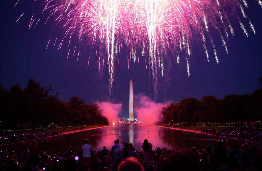 Fireworks illuminate the National Mall in celebration of Independence Day 2018 in Washington. Photo: Washington Post Photo By Calla Kessler. / The Washington Post