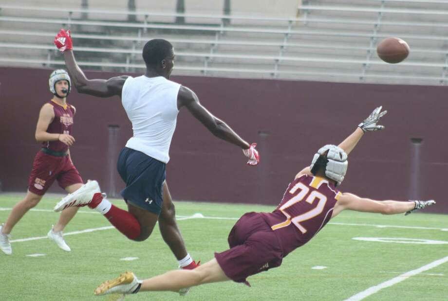 Deer Park's Brett Hiller gets tripped up as he went for this pass during the team's last 7-on-7 assignment. This Thursday, the league concludes. Photo: Robert Avery