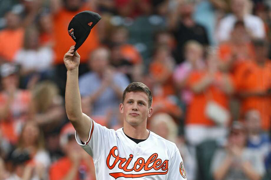Adley Rutschman, the top pick in the recent draft, tips his cap to the crowd at the Orioles' home game against the Padres. Photo: Patrick Smith / Getty Images