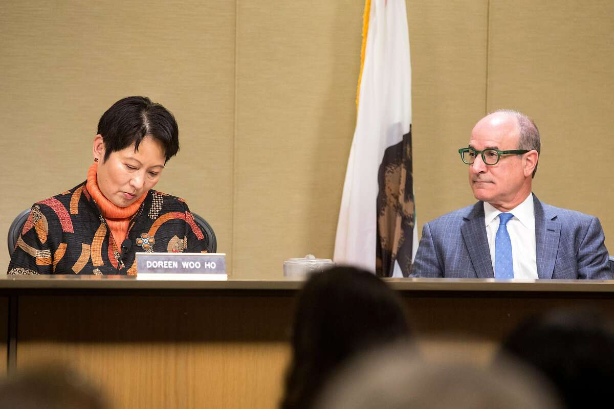 Doreen Woo Ho and Victor Makras during the Port Commission meeting at Ferry Building that will determine whether a homeless navigation center/shelter will be built on the Embarcadero. Tuesday, April 23, 2019. San Francisco, Calif.