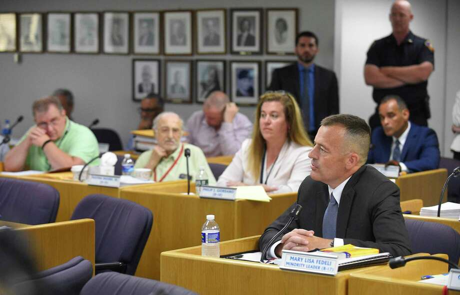 Chris Murtha, deputy chief of the Prince George's County Police Department in Maryland, faces a line of questions by Stamford representatives on the city's Appointment Committee before hundreds of residents packed in the Legislative Chambers of the Stamford Government Center on June 22. Photo: Matthew Brown / Hearst Connecticut Media / Stamford Advocate