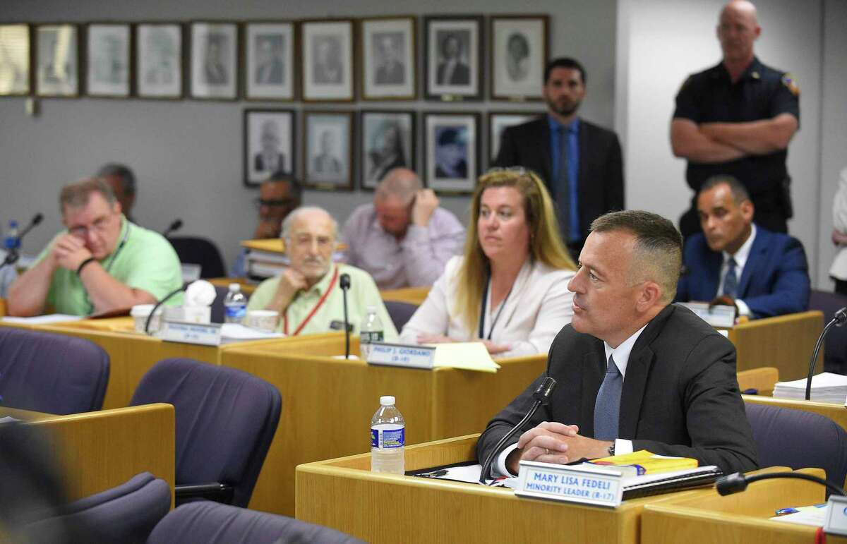Chris Murtha, deputy chief of the Prince George's County Police Department in Maryland, faces a line of questions by Stamford representatives on the city's Appointment Committee before hundreds of residents packed in the Legislative Chambers of the Stamford Government Center on June 22.