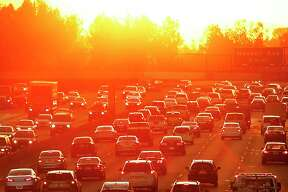 Traffic on the 101 Freeway in Los Angeles during a heat wave. Hotter days caused by climate change are driving up energy consumption and increasing greehnouse gas emissions, according to economists and scientists.