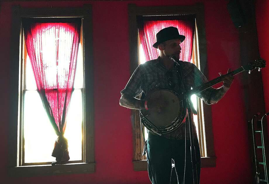 Jacob McGreevy takes the stage at the inaugural Our Tyme Music Fest at the Red Room Lounge on Crockett Street Saturday. The event featured 11 area folk artists and is slated to be an annual addition to the city's summer music festivals. Photo taken Saturday, June 24, 2017 Kim Brent/The Enterprise Photo: Kim Brent / Beaumont Enterprise / BEN