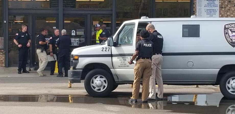 Port Arthur police investigate the reported robbery of an armored vehicle at Market Basket on West Port Arthur Road Wednesday, June 26, 2019. Photo: Guiseppe Barranco/The Enterprise Photo: Guiseppe Barranco/The Enterprise