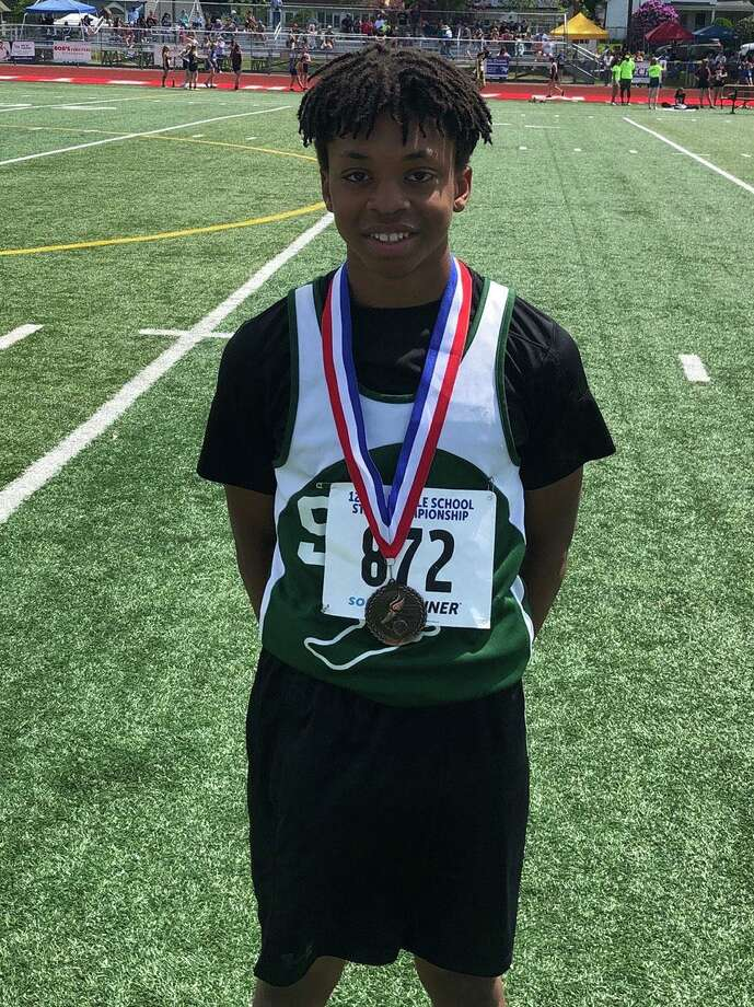 New Milford's Schaghticoke Middle School boys' track & field team dominated the competition this spring, as they finished with an undefeated regular season. The team also finished second in the state championships at Manchester High May 25 and first in the Western CT Conference finals at Brookfield High School June 1, 2019. Jalen Greene, above, placed third at states for the hurdles. Photo: Courtesy Of SMS / The News-Times Contributed