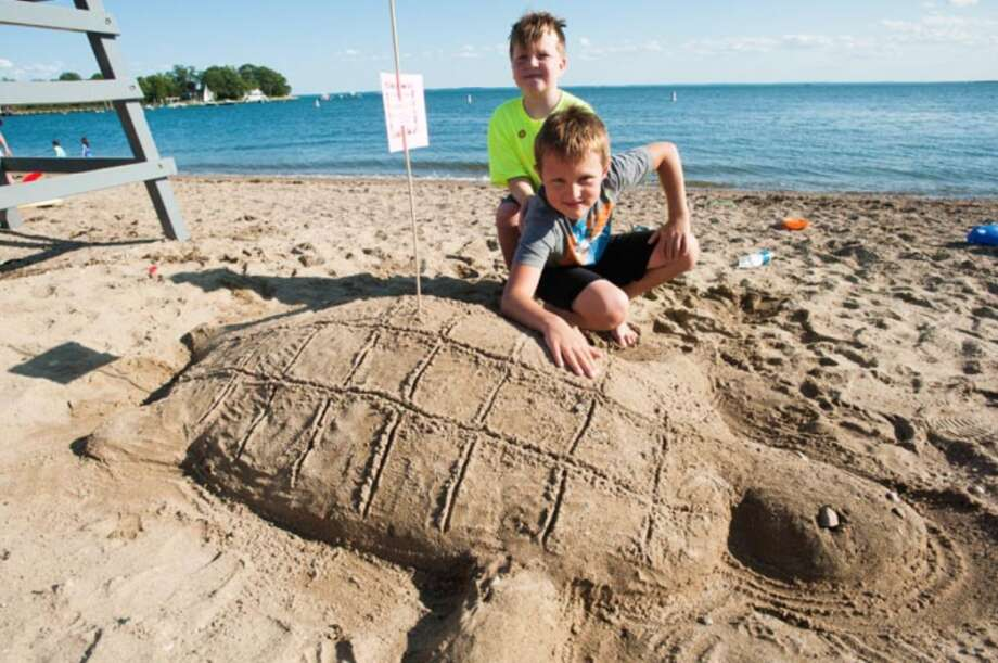 Harry Starling, left and James Coe created Florida Box Turtle at the sand castle contest in 2017. — Laureen Vellante photo