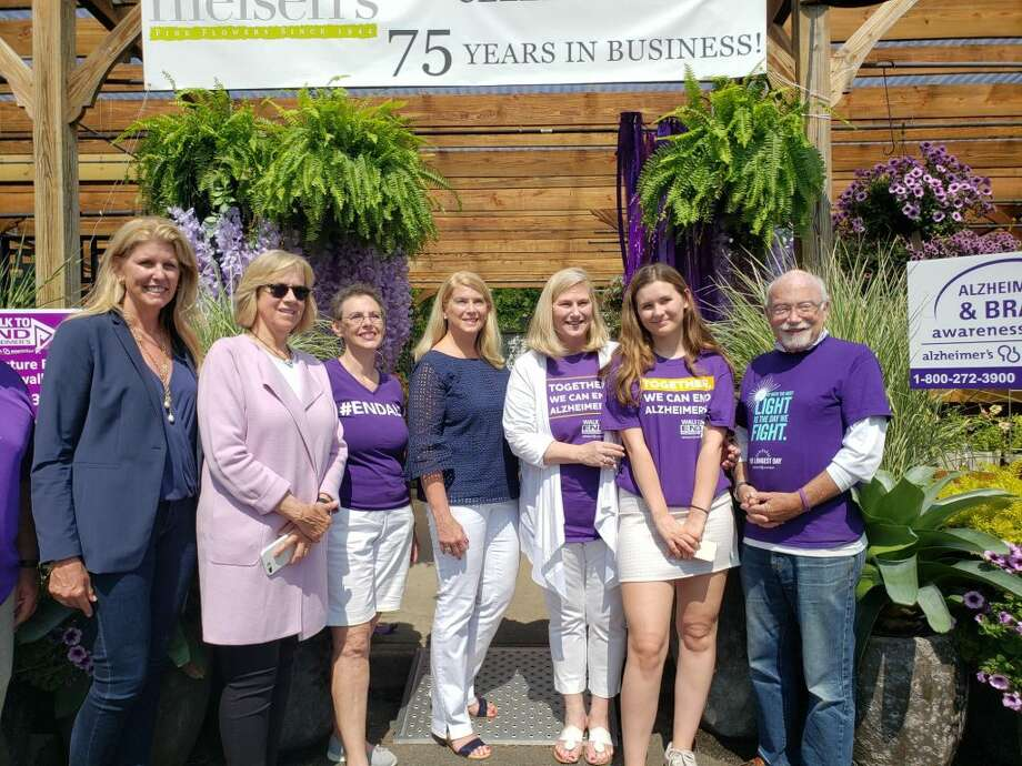 More than a dozen volunteers and elected officials took part in the Darien Paint the Town Purple event. — Sandra Diamond Fox photo