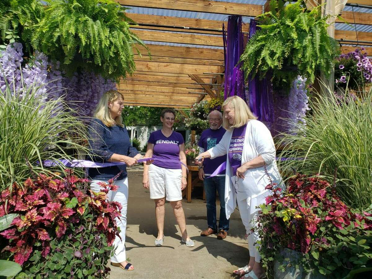 Pamela Payne, chairman of Darien's Paints the Town Purple event, standing with First Selectman Jayme Stevenson, cuts the ribbon at Darien's Paints the Town Purple event on Saturday, June 22. - Sandra Diamond Fox photo