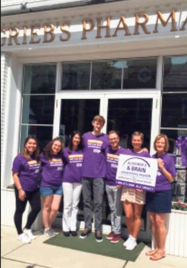 Grieb's Pharmacy Team wears purple to show their support for the upcoming Paint the Town Purple Event