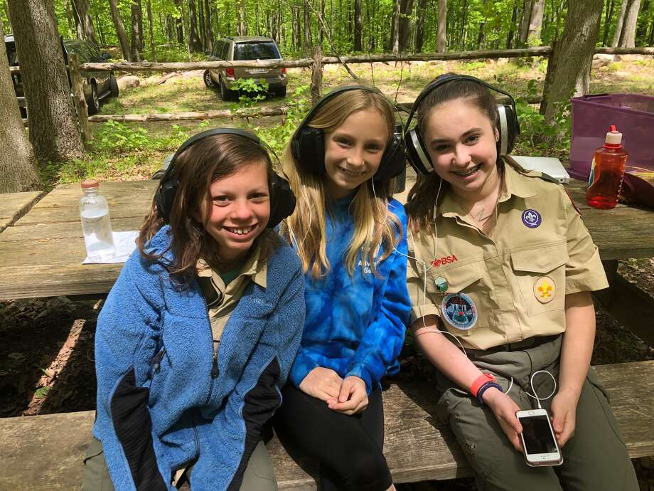 Ear protection during rifle shooting merit badge at the Spring STEM Camporee (Hoyt). From left, Pippa Morgan, Kate Johnson and Mattie Dickinson