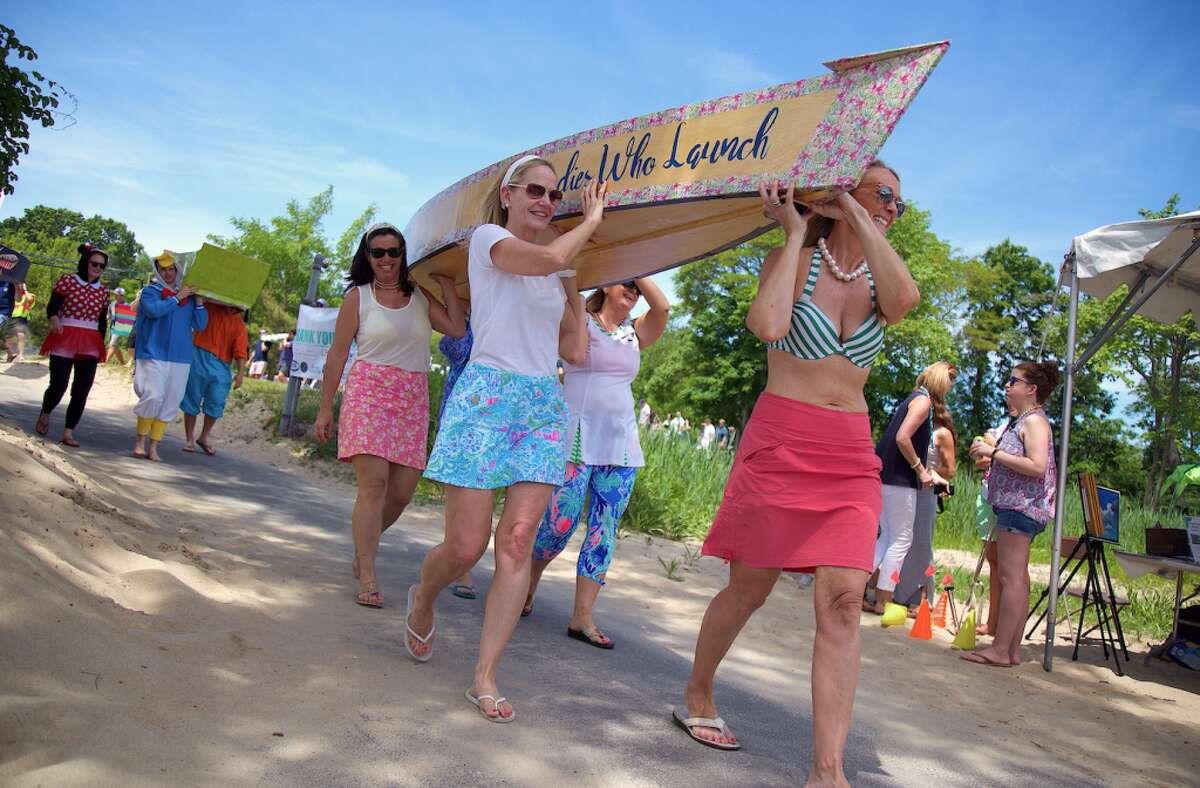 The Ladies Who Launch team from Darien take part in the boat parade.