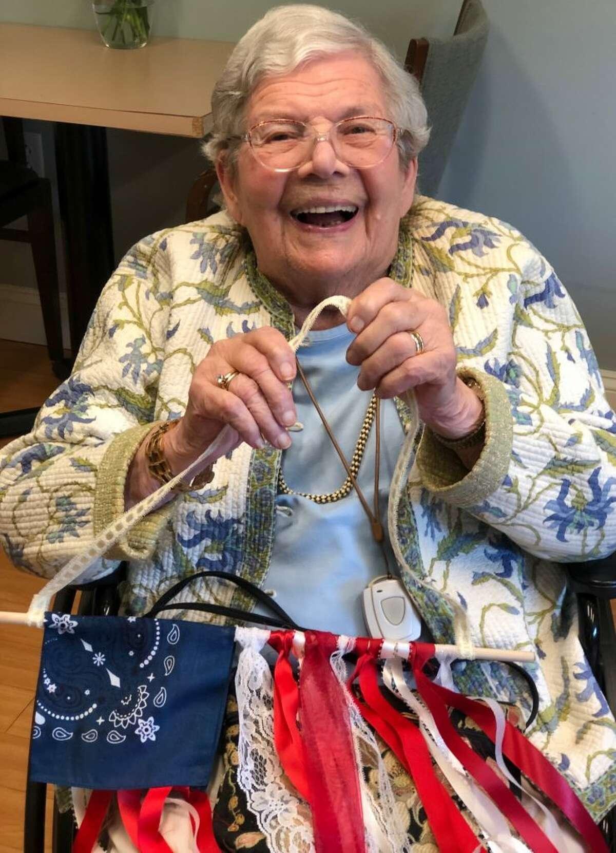 Eileen Johnson making a flag for Memorial Day.