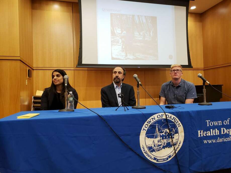 Experts on ticks and Lyme disease, from left, Asha Shah, Goudarz Molaei and Joseph McMillan, give a talk at the Darien Library called Fight the Bite. — Sandra Diamond Fox photo