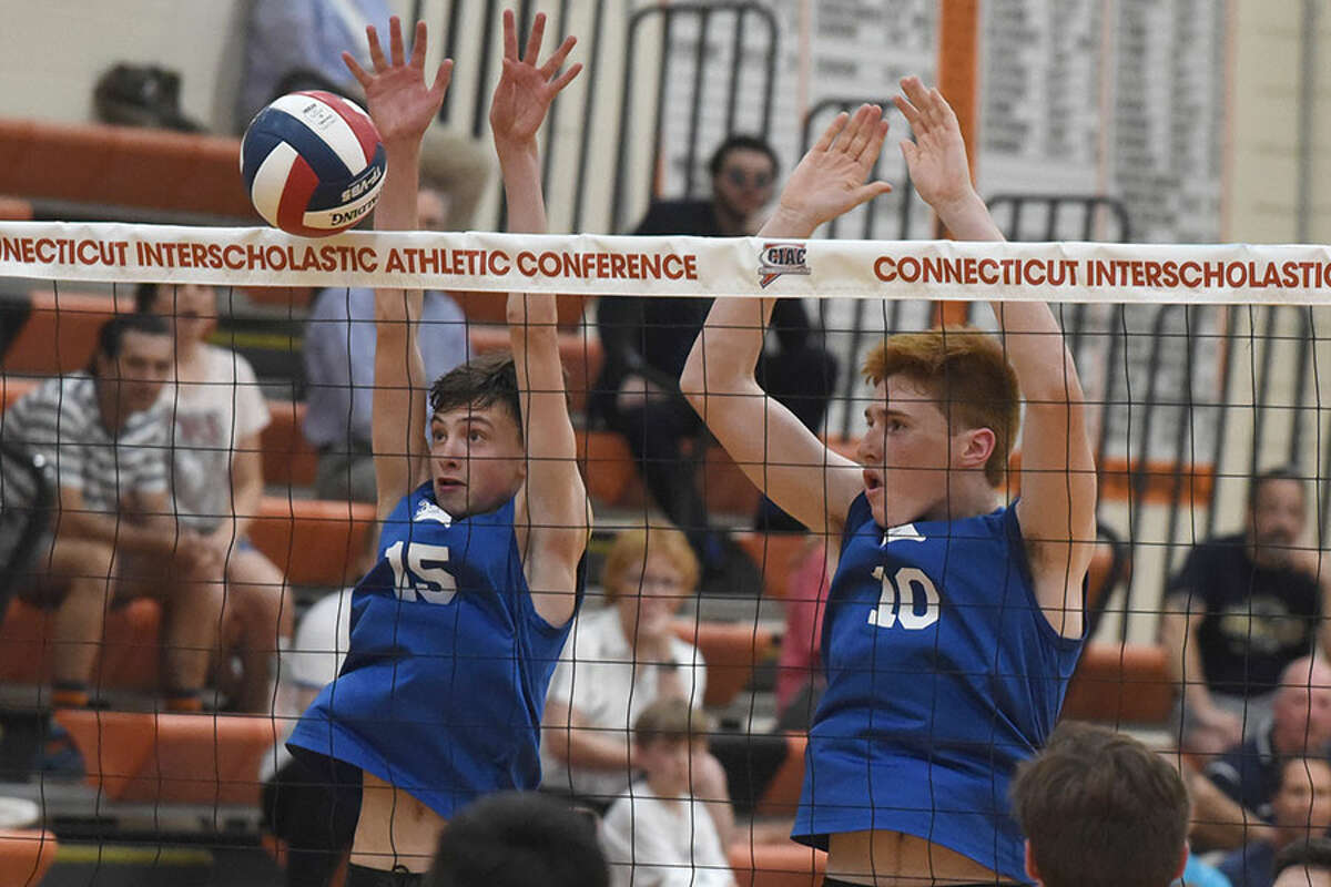 Darien's Jackson Leone (15) and Frank Pirone (10) go up for a block during the CIAC Class L final between Darien and Staples in Shelton on Thursday. - Dave Stewart/Hearst Connecticut Media
