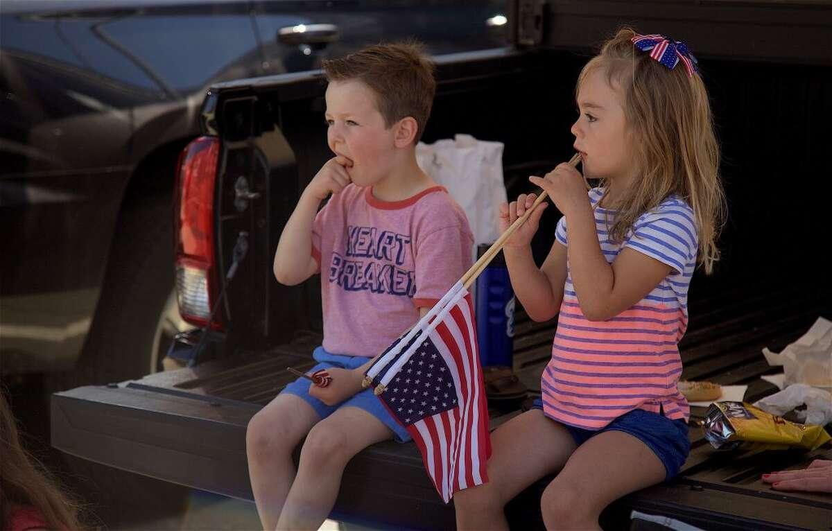 Derek Nyarady, 4, and Luna Bartolotta, 4, both of Darien, get ready for the parade to start.