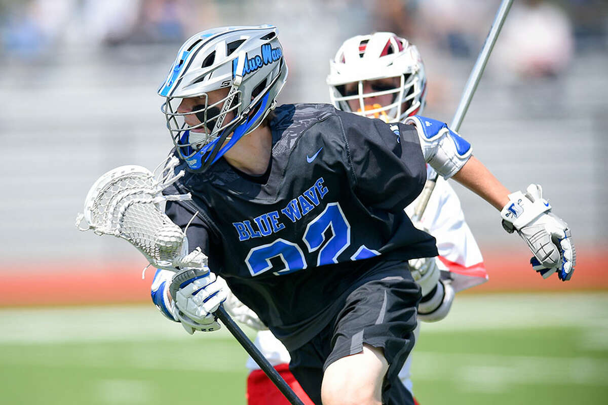 Darien's Jack Bogdan (32) drives up the field during a boys lacrosse game against Greenwich at Cardinal Stadium on Saturday. - Matthew Brown/Hearst Connecticut Media