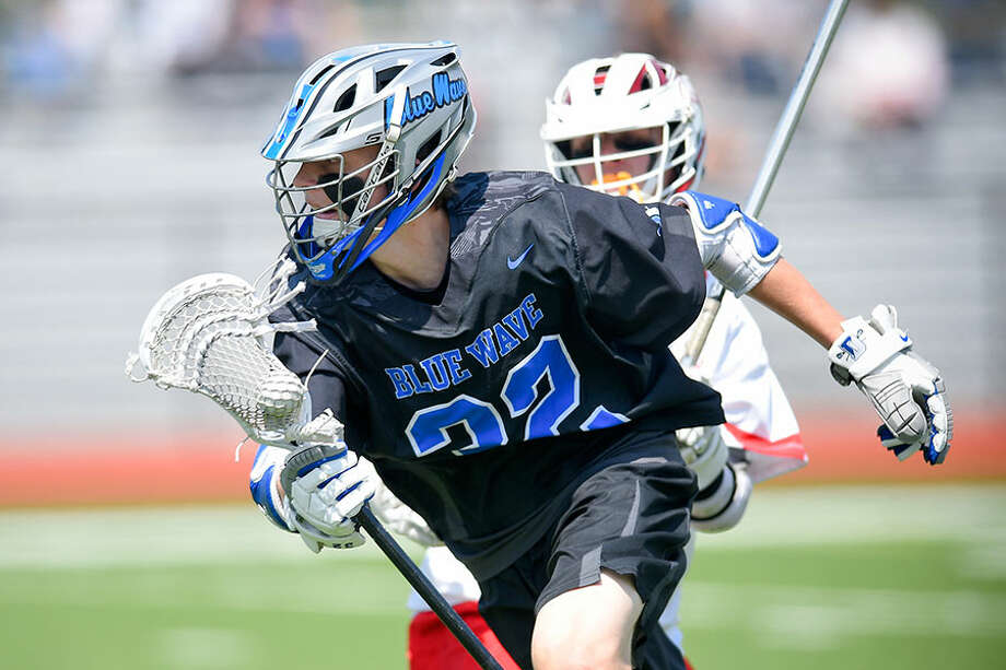 Darien's Jack Bogdan (32) drives up the field during a boys lacrosse game against Greenwich at Cardinal Stadium on Saturday. — Matthew Brown/Hearst Connecticut Media / Stamford Advocate