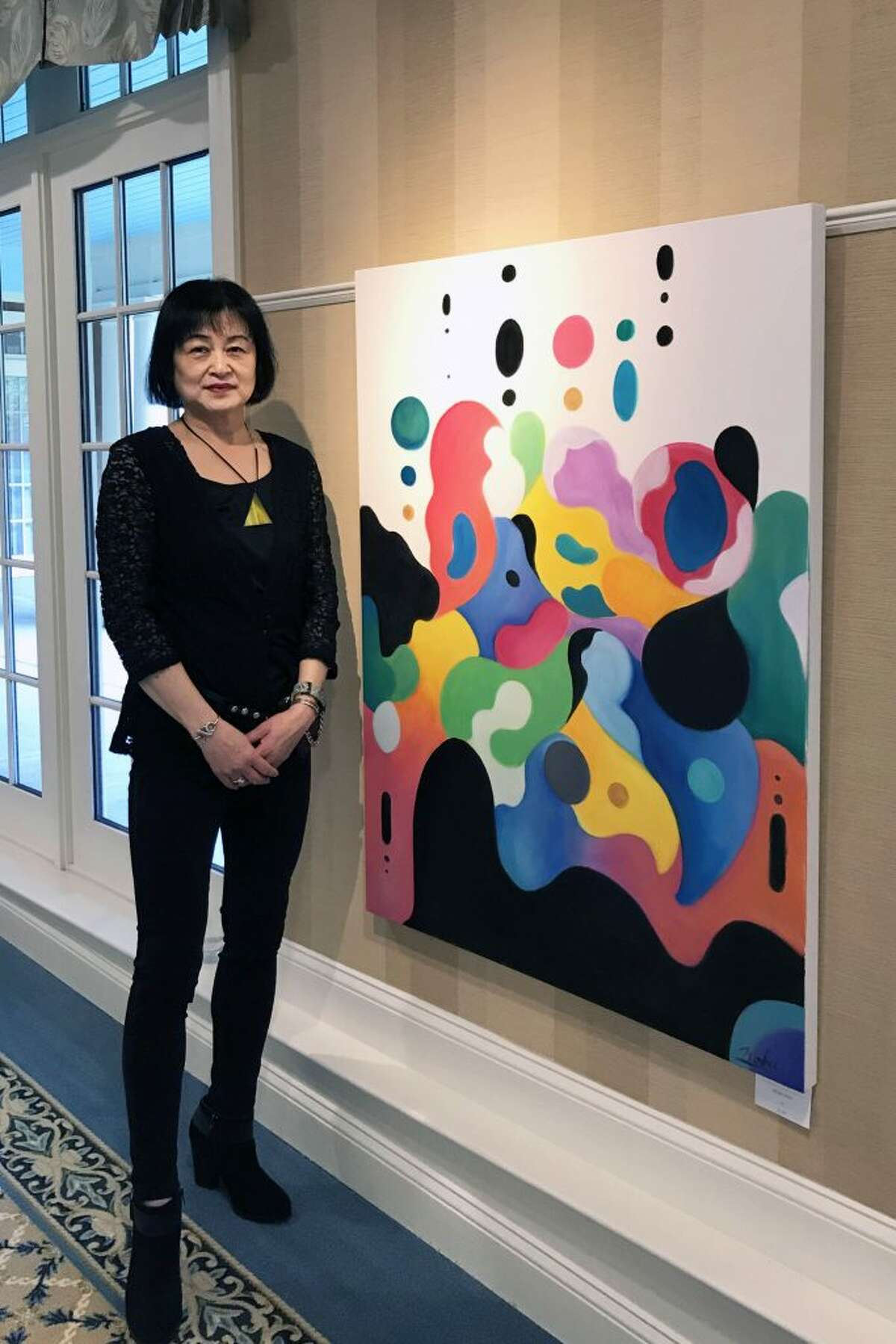 Darien folk artist Nobu Miki with her new painting,