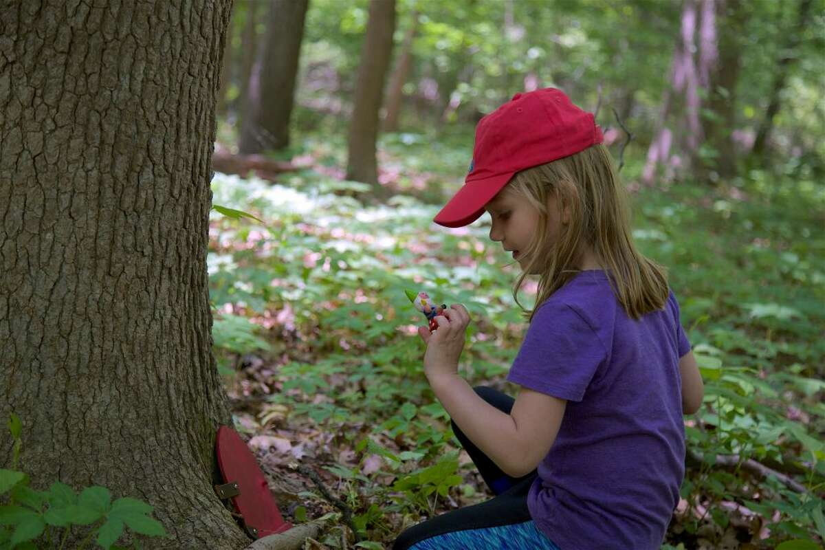 Olivia Harris, 4, of Stamford, discovers a gnome living in the woods