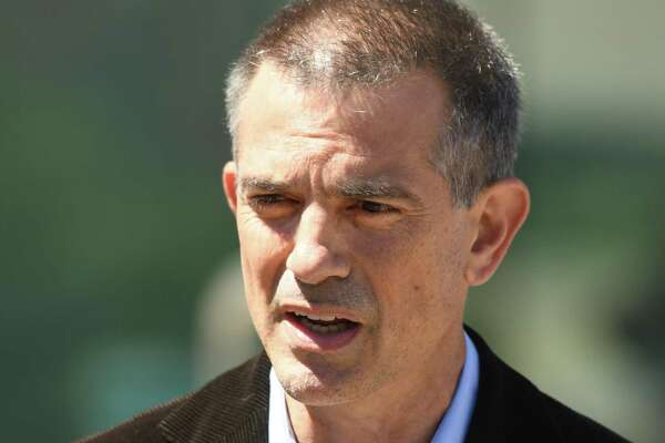 Fotis Dulos speaks after making an appearance at Connecticut Superior Court in Stamford, Conn. Wednesday, June 26, 2019. Fotis Dulos appeared with his attorneys, Norm Pattis and Rich Rochlin, for a hearing Wednesday on motion by a divorce attorney for Jennifer Dulos to have Fotis Dulos and his attorneys held in contempt and for the court to impose sanctions for violating a judge's order that sealed a custody and psychological evaluation conducted on the Dulos family.