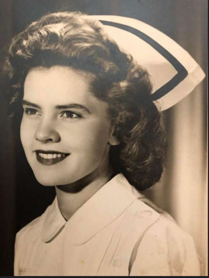 Pat Parlette in her white nurse's uniform when she flew for Seaboard