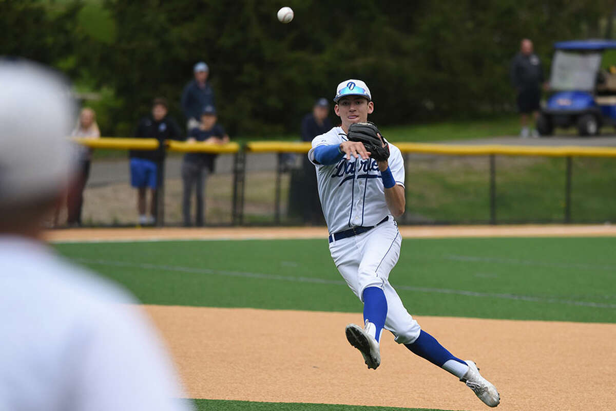 Darien shortstop Henry Williams (11) fires the ball to first base during the Blue Wave's baseball game against Staples at Darien High School on Monday, May 6, 2019. - Dave Stewart/Hearst Connecticut Media