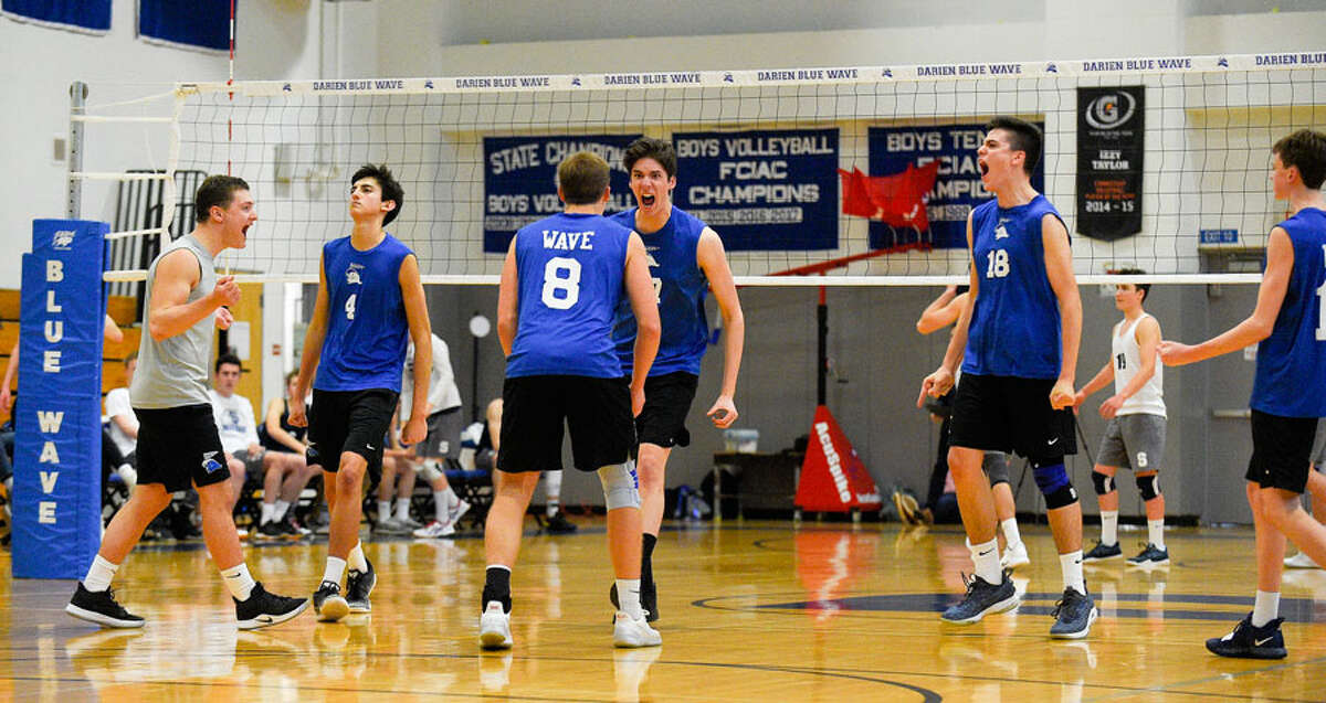 The Darien Blue Wave celebrates a point during their 3-0 win over Staples on Wednesday, May 1, at DHS. - Matthew Brown/Hearst Connecticut Media
