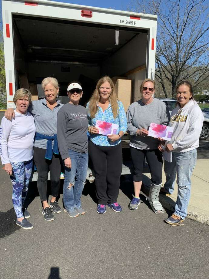 Members of the Garden Club of Darien prep and stage for the May 7 to 9 Persephone Flower Show at The Tokeneke Club. This show is open to the public.