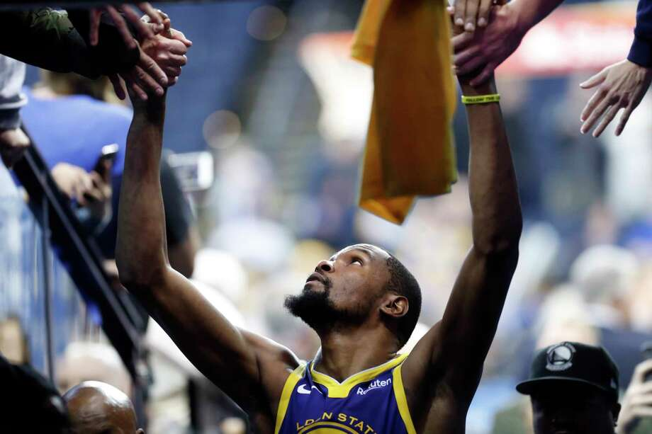 Golden State Warriors' Kevin Durant interacts with fans after scoring 49 points during 116-110 win over Orlando Magic during NBA game at Oracle Arena in Oakland, Calif. on Monday, November 26, 2018. Photo: Scott Strazzante, The Chronicle / San Francisco Chronicle