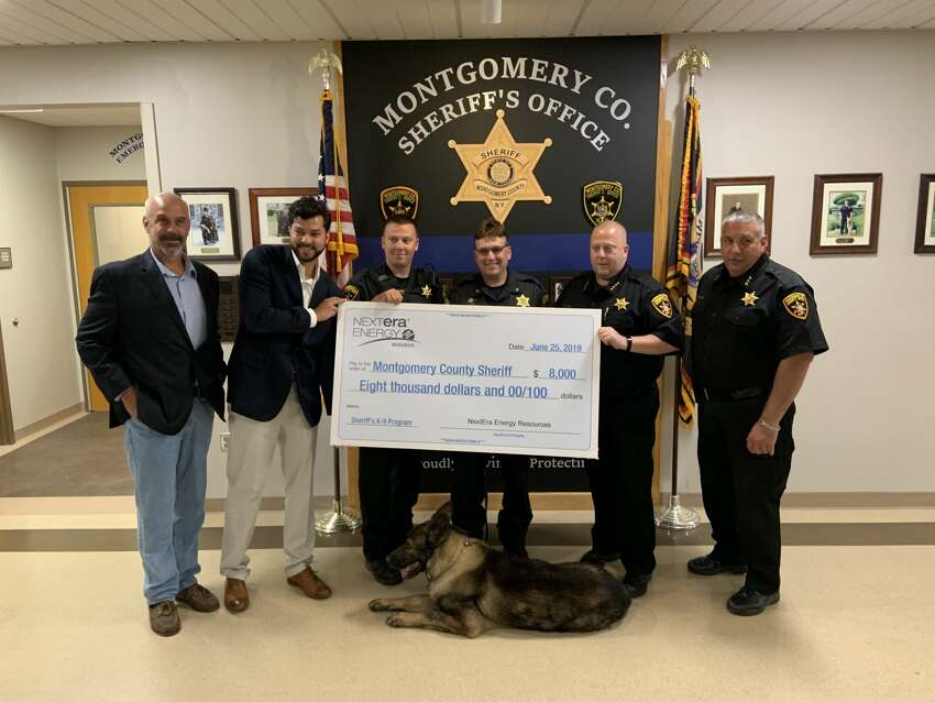 The Montgomery County Sheriff's office received a donation of $8,000 on Tuesday, June 26, 2019, to buy a new dog for their K-9 program from NextEra Energy Resources. Present for the presentation were Sheriff Jeff Smith and Keddy Chandran, project director at NextEra as well as the K-9 team, including team dog Kilo.