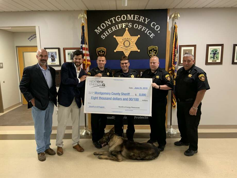 The Montgomery County Sheriff's office received a donation of $8,000 on Tuesday, June 26, 2019, to buy a new dog for their K-9 program from NextEra Energy Resources.  Present for the presentation were Sheriff Jeff Smith and Keddy Chandran, project director at NextEra as well as the K-9 team, including team dog Kilo. Photo: NextEra Energy Resources