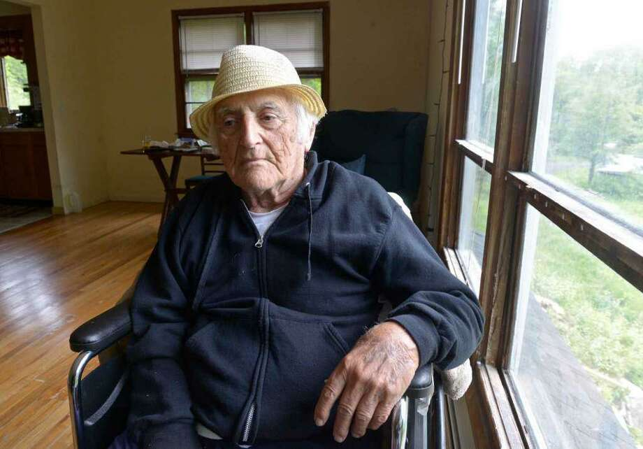 Lou Russo, 96, sits in his New Fairfield, Conn, home on Wednesday, May 20, 2015. Russo, a World War II veteran, was put in a nursing home by a court-order conservator, who also spent his life savings and rented his home to others. Russo got good news in probate court, the conservator has been ordered to pay him $34,000. Photo: H John Voorhees III