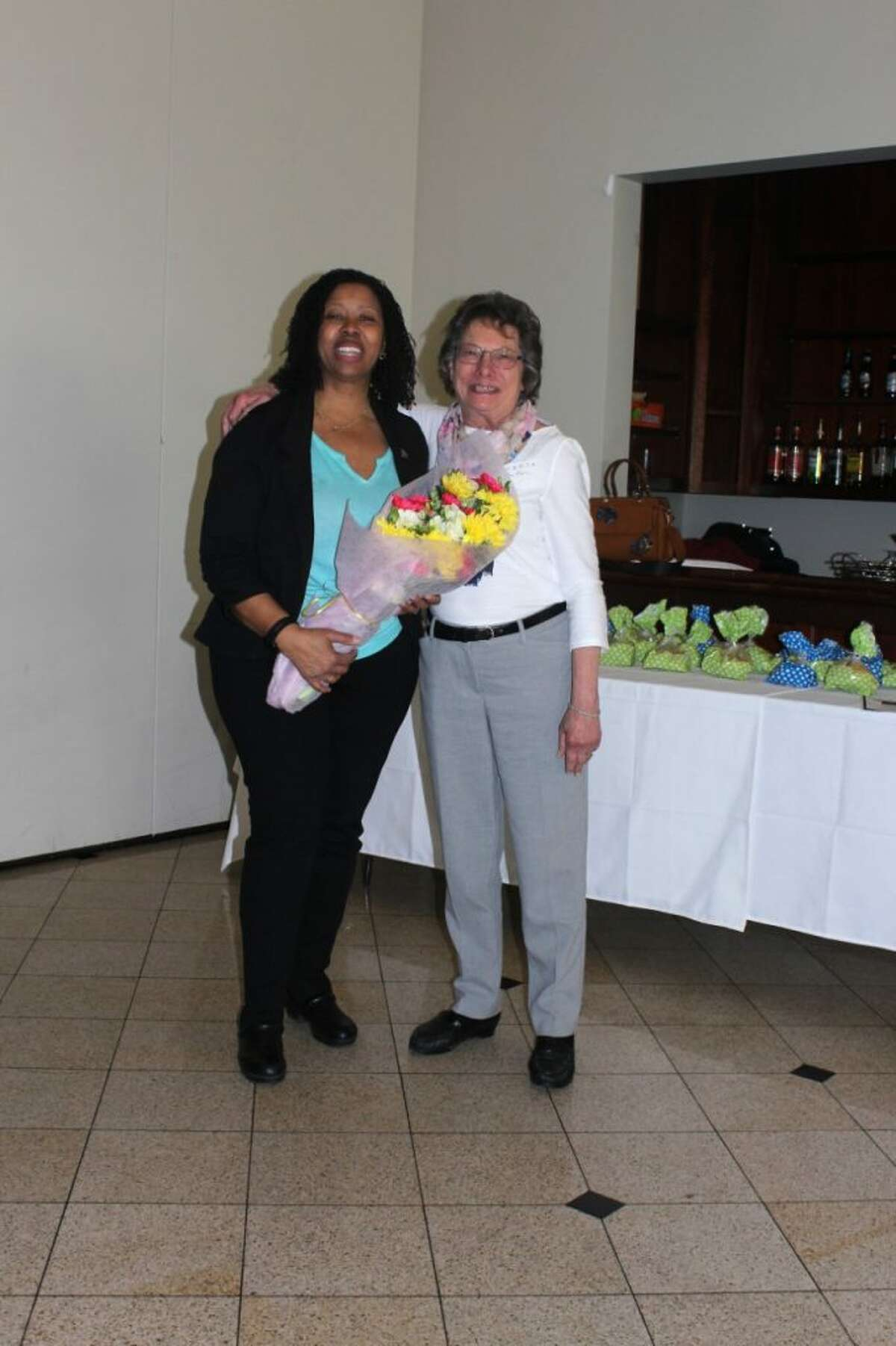 Choir director and music teacher Sheena Graham accepts flowers from GBRTA first vice-president Rose Marie D'Aquila of Trumbull.