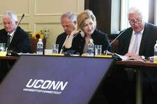 UConn Board of Trustees members, from left, Denis Nayden, Andy Bessette, UConn President Susan Herbst, and interim board chairman Tom Ritter, attend a public board meeting, Wednesday. The board voted to accept an invitation to move most of the school's athletic teams from the American Athletic Conference to the Big East.