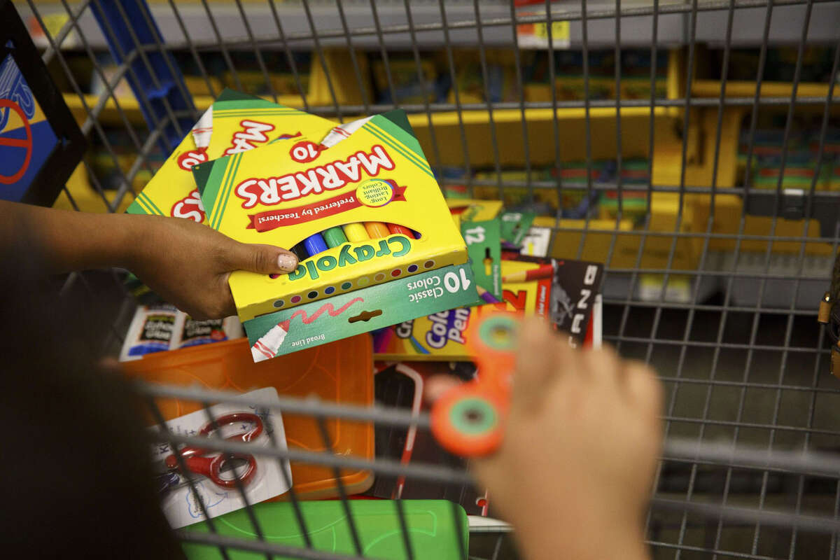 Customers browse Crayola school supplies displayed for sale at a Wal-Mart Stores Inc. location in Burbank, Calif., on Aug. 8, 2017.