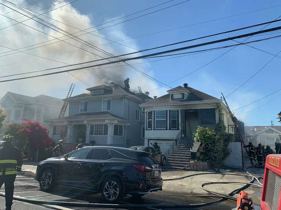 Firefighters respond to a 2-Alarm fire at 1061 47th Ave. that spread to 1063 & 1065 47th Ave in Emeryville on June 26, 2019 Photo: Emeryville Fire