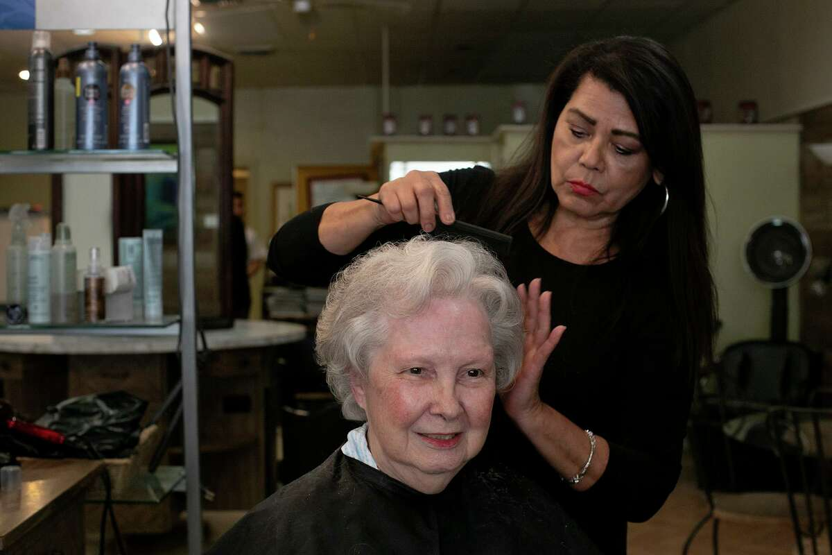 Adrienne Weynand, 91, gets her hair styled by Mary Morales, the owner of Vee's Hair and Spa, at the salon in San Antonio. Vee's first opened in 1948 as Bowman's Beauty Salon.