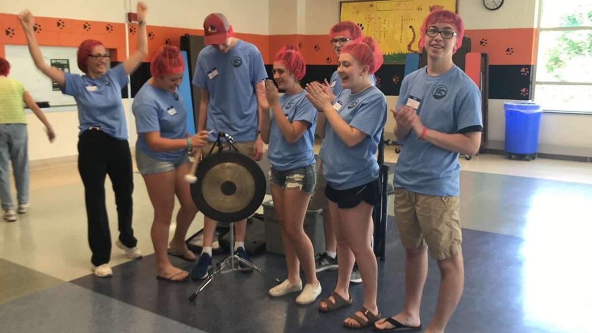 Almost 100 volunteers turned out to the Rise Against Hunger event at East Ridge Middle School in Ridgefield on June 8. The volunteers packed 15,120 meals in just two hours. The food-packaging event was organized by members of the Jesse Lee United Methodist Church youth ministry.