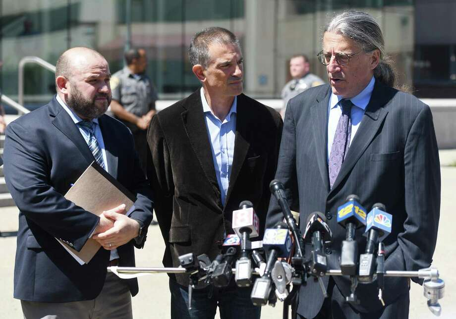 Fotis Dulos, center, is accompanied by his attorneys Rich Rochlin, left, and Norm Pattis after making an appearance at Connecticut Superior Court in Stamford, Conn. Wednesday, June 26, 2019. Photo: Tyler Sizemore / Hearst Connecticut Media / Greenwich Time